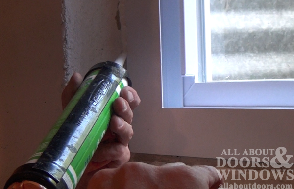caulk replacement windows